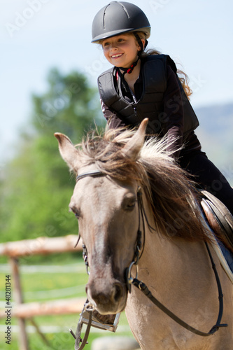 Horse riding - portrait of lovely equestrian on a horse - 48281344