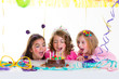 children kid girls birthday party look excited chocolate cake