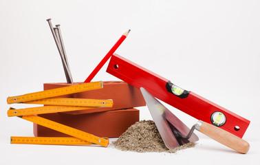 sand pile, bricks and mason tools