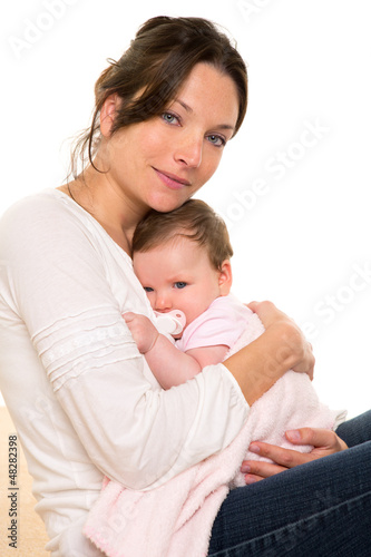Baby girl relaxed with pacifier hug in mother arms