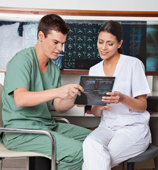 Medical Technicians Discussing About X-ray