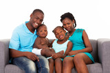 happy african american family sitting on sofa