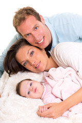 Baby girl mother and father family happy lying together