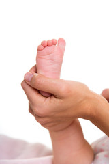 Mother hands holding baby nude feet on white