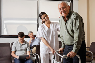 Nurse Helping Senior Patient With Walker