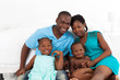 happy african american family in bedroom