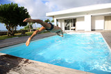 Man diving in private swimming-pool