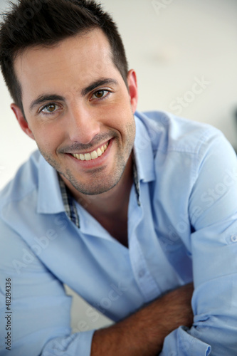 Portrait of handsome young man with blue shirt