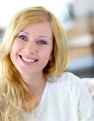 Portait of beautiful blond smiling woman