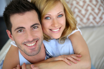 Portrait of cheerful in love couple at home