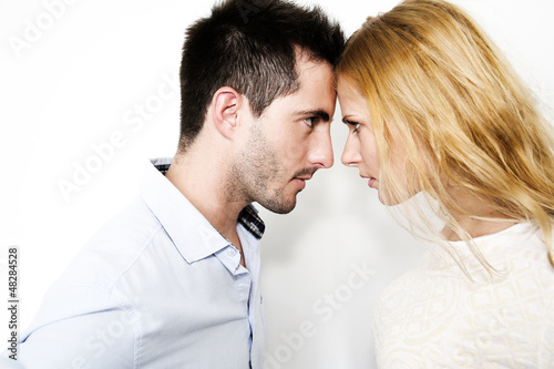 Couple on white background touching foreheads