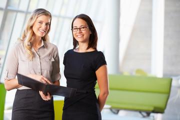 Businesswomen Having Informal Meeting In Modern Office