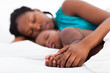 loving african mother napping with baby boy