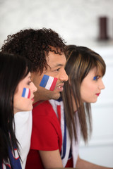 A group of French supporters watching a football game