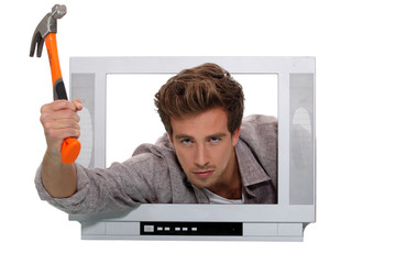 Concept shot of a man trying to break into telly