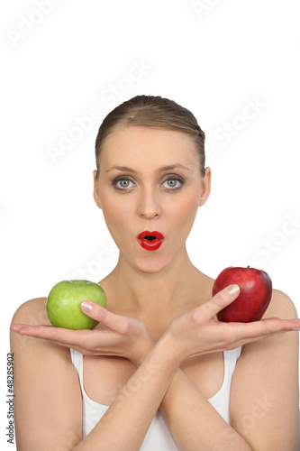 Pretty woman with apples in hands