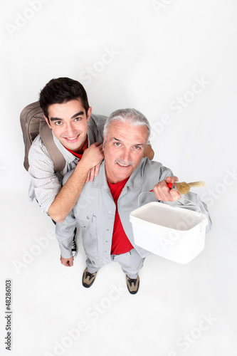 high angle view of painter and young apprentice