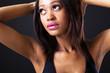 cute african american fashion model on black background
