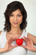 Brunette holding a small red heart