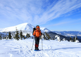 Winter hiking in snowshoes.