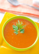 Fresh soup from pumpkin in the green bowl