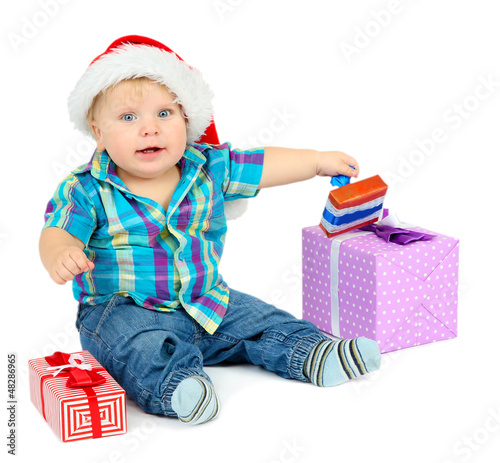 Little boy with gift, isolated on white
