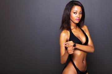 sexy young african american woman on black background