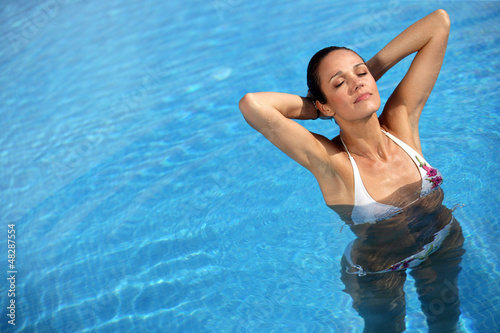 Sexy woman swimming in a pool