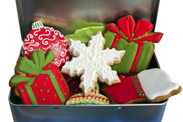 Iced Christmas cookies in a tin box.
