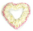 Beautiful heart of white rose petals surrounded by pink petals
