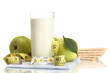 Glass of kefir, green apples, crispbreads and measuring tape
