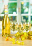 White wine in glass with bottle on window background - 48288988