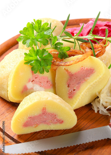 Meat stuffed potato dumplings with shredded cabbage