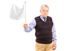 A sad senior man waving a white flag