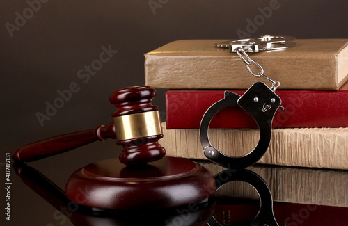 Gavel, handcuffs and.books on law isolated on black