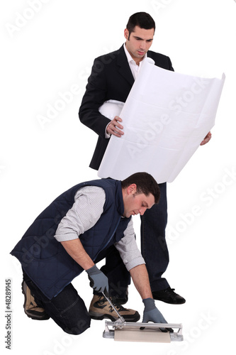 tiler and businessman posing together
