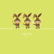 3 Bunnies Holding Spring Flowers Green