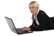 Businesswoman laid in front of computer