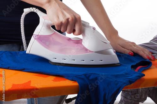 Woman ironing T-shirt, laundry