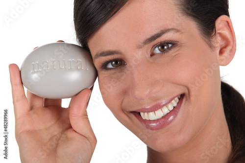 Woman holding large pebble