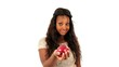 Young African American teenage girl sharing an apple