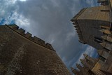 Fisheye view of a medieval castle against cloudy sky