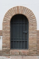Large window or door with grate and metal mesh