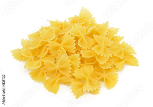 Heap of farfalle pasta isolated on white background