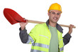 Tradesman carrying a spade on his shoulders
