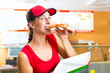 Woman eating a slice of pizza