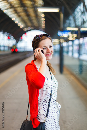 Pretty young woman at a train station