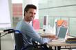 Man sitting at desk in wheelchair