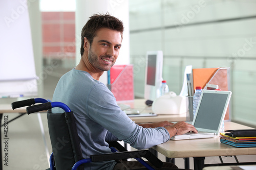 Man sitting at desk in wheelchair