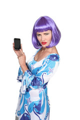 Woman wearing purple wig using mobile telephone